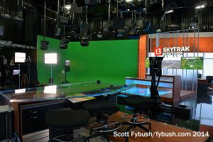 Behind the desk on the new set